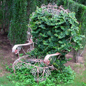 92547918_4497432_plantingflowersinchairs42